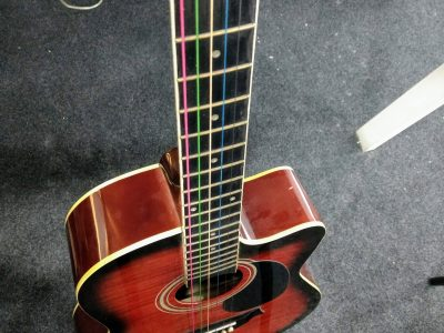 Acoustic guitar with new rainbow string